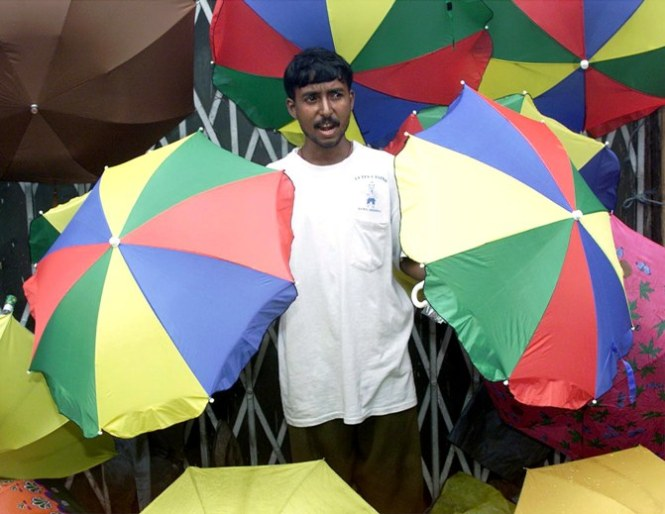 Hawker who sell umbrellas by the road side in mumbai