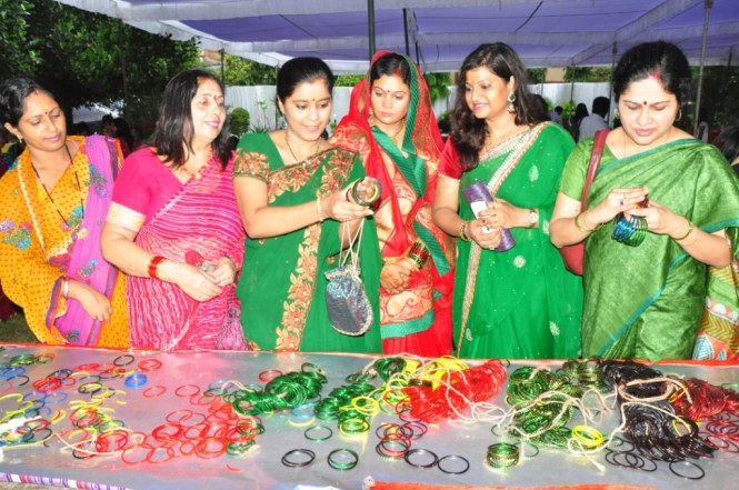 Women wearing green sarees, green & gold bangles on Teej Festival