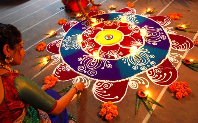Decorated the house with Rangoli and Earthen Lamps